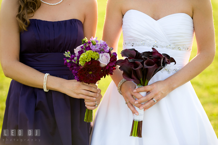 Bride and Bridesmaid showing their flower bouquets. St Andrews United Methodist wedding photos at Annapolis, Eastern Shore, Maryland by photographers of Leo Dj Photography.