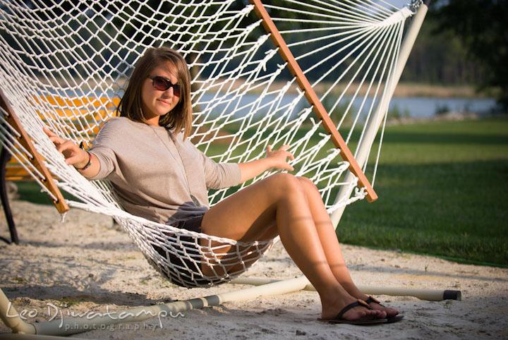 Girl lounging on hammock. Eastern Shore, Maryland, Kent Island High School senior portrait session by photographer Leo Dj Photography.