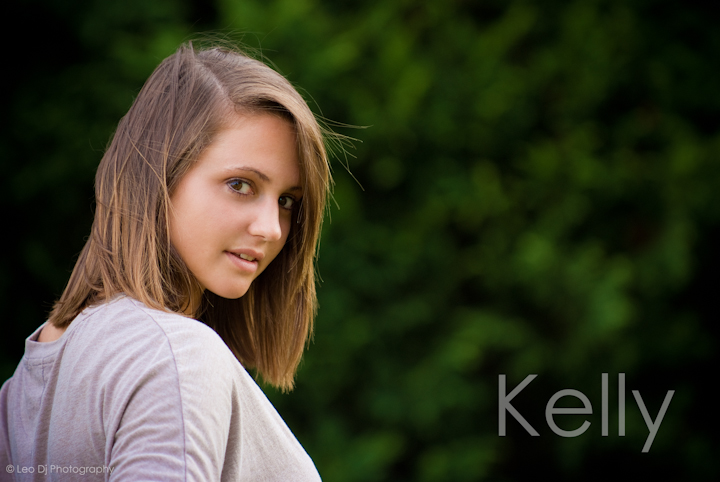 Girl looking over shoulder. Eastern Shore, Maryland, Kent Island High School senior portrait session by photographer Leo Dj Photography.