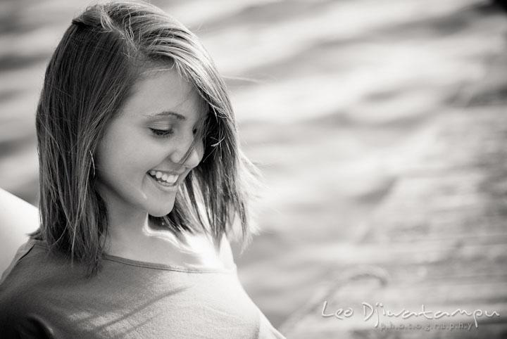 Girl on pier smiling. Eastern Shore, Maryland, Kent Island High School senior portrait session by photographer Leo Dj Photography.
