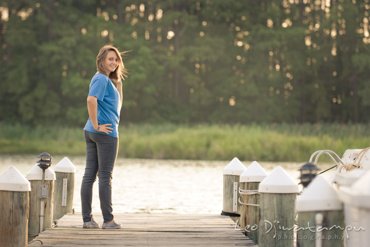 Girl posing on a boat pier at sunset. Eastern Shore, Maryland, Kent Island High School senior portrait session by photographer Leo Dj Photography.