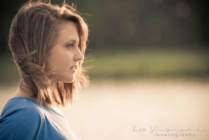 Girl looking at a distance, windblown hair. Eastern Shore, Maryland, Kent Island High School senior portrait session by photographer Leo Dj Photography.