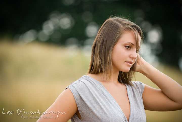 Girl brushing her hair with her fingers. Eastern Shore, Maryland, Kent Island High School senior portrait session by photographer Leo Dj Photography.