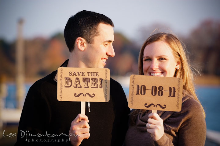 Engaged guy and girl holding their save the date cards. Chestertown Maryland and Washington College Pre-Wedding Engagement Session Photographer, Leo Dj Photography