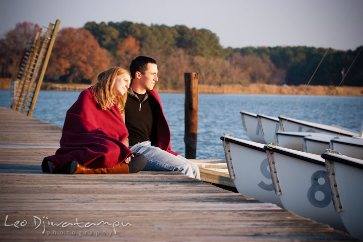 Fiancée leaning on fiancé's shoulder looking at the creek. Chestertown Maryland and Washington College Pre-Wedding Engagement Session Photographer, Leo Dj Photography