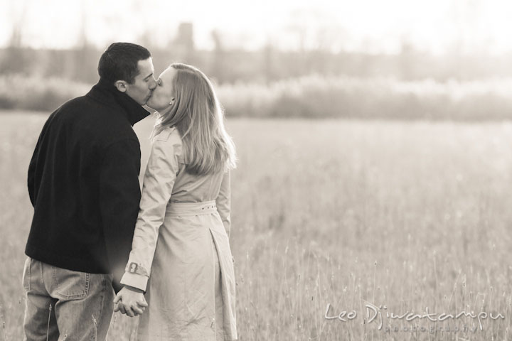 Engaged guy kissing his fiancée in a meadow. Chestertown Maryland and Washington College Pre-Wedding Engagement Session Photographer, Leo Dj Photography
