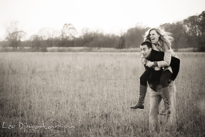 Engaged couple in a grass field goofing around. Chestertown Maryland and Washington College Pre-Wedding Engagement Session Photographer, Leo Dj Photography