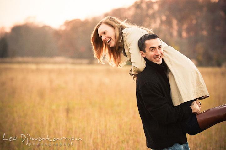 Engaged guy carried his fiancée on his shoulder. Chestertown Maryland and Washington College Pre-Wedding Engagement Session Photographer, Leo Dj Photography