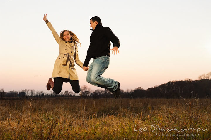 Engaged guy and girl jumping high up in the air. Chestertown Maryland and Washington College Pre-Wedding Engagement Session Photographer, Leo Dj Photography