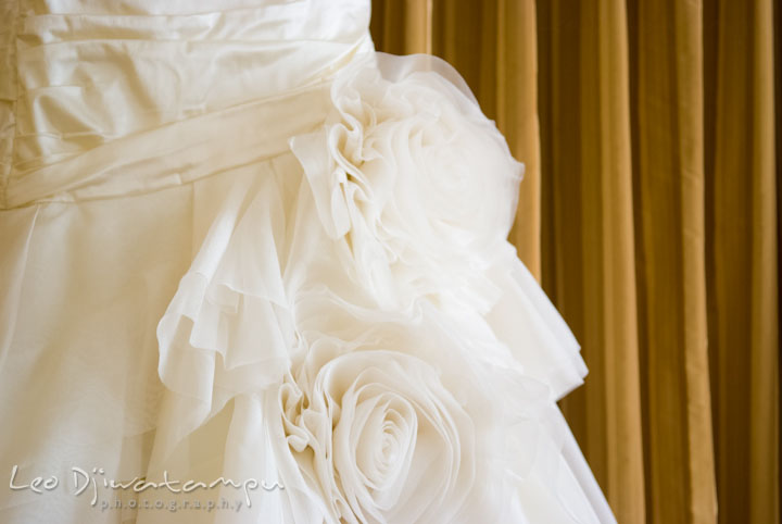 Wedding dress flower details. The Tidewater Inn Wedding, Easton Maryland, getting ready photo coverage of Kelsey and Jonnie by wedding photographers of Leo Dj Photography.