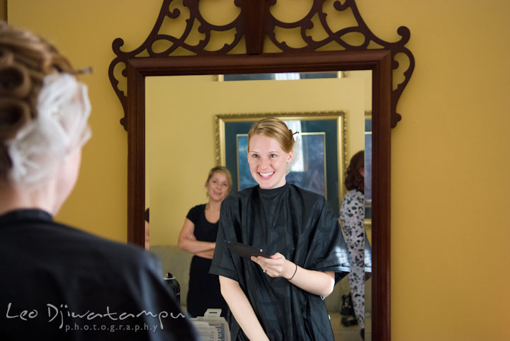 Bride looking at mirror checking out her hair do. The Tidewater Inn Wedding, Easton Maryland, getting ready photo coverage of Kelsey and Jonnie by wedding photographers of Leo Dj Photography.