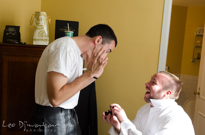 Best man showing wedding band to Groom. The Tidewater Inn Wedding, Easton Maryland, getting ready photo coverage of Kelsey and Jonnie by wedding photographers of Leo Dj Photography.