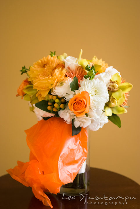 Orange flower bouquet. The Tidewater Inn Wedding, Easton Maryland, getting ready photo coverage of Kelsey and Jonnie by wedding photographers of Leo Dj Photography.