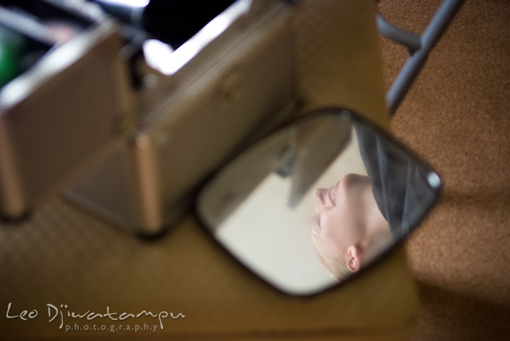Reflection of bride on small makeup mirror. The Tidewater Inn Wedding, Easton Maryland, getting ready photo coverage of Kelsey and Jonnie by wedding photographers of Leo Dj Photography.
