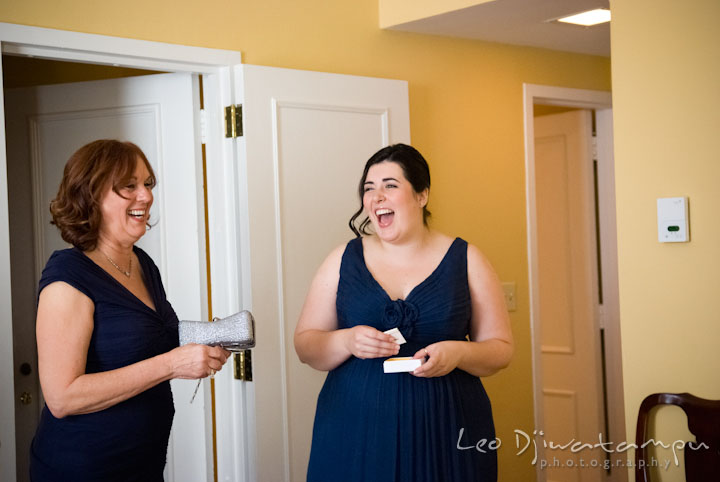 Mother of the bride and maid of honor laughing. The Tidewater Inn Wedding, Easton Maryland, getting ready photo coverage of Kelsey and Jonnie by wedding photographers of Leo Dj Photography.