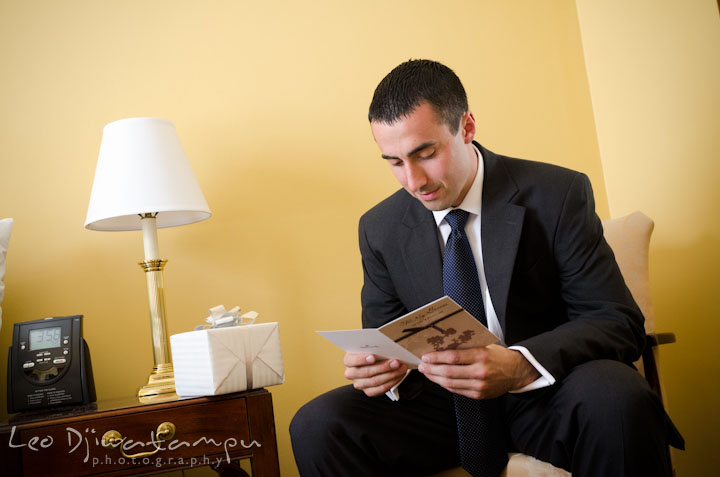 Groom reading card from bride. The Tidewater Inn Wedding, Easton Maryland, getting ready photo coverage of Kelsey and Jonnie by wedding photographers of Leo Dj Photography.