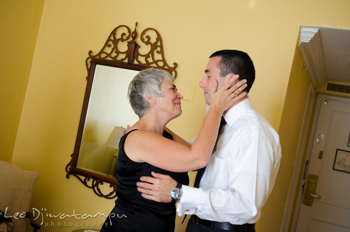 Mother of the groom holding her son with proud and joy. The Tidewater Inn Wedding, Easton Maryland, getting ready photo coverage of Kelsey and Jonnie by wedding photographers of Leo Dj Photography.