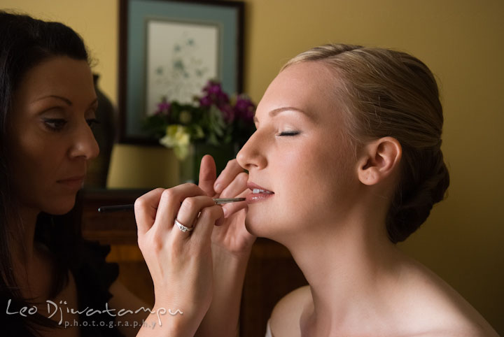 Angela Papa's, Behind the Veil make up artist putting lipstick on bride. The Tidewater Inn Wedding, Easton Maryland, getting ready photo coverage of Kelsey and Jonnie by wedding photographers of Leo Dj Photography.