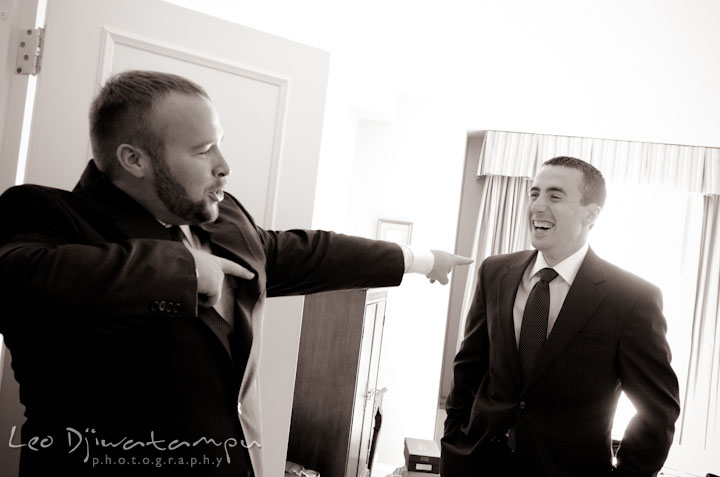 Groom goofing around with best man. The Tidewater Inn Wedding, Easton Maryland, getting ready photo coverage of Kelsey and Jonnie by wedding photographers of Leo Dj Photography.