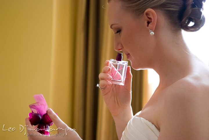 Bride smelling the Lovestruck perfume bottle, by Vera Wang. The Tidewater Inn Wedding, Easton Maryland, getting ready photo coverage of Kelsey and Jonnie by wedding photographers of Leo Dj Photography.