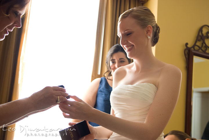 Bride opening gift from groom. The Tidewater Inn Wedding, Easton Maryland, getting ready photo coverage of Kelsey and Jonnie by wedding photographers of Leo Dj Photography.