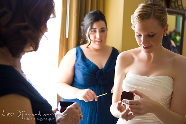 Bride looking at earring gift from groom. The Tidewater Inn Wedding, Easton Maryland, getting ready photo coverage of Kelsey and Jonnie by wedding photographers of Leo Dj Photography.