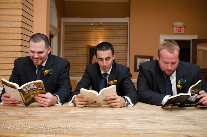 Groom and best men reading books. The Tidewater Inn Wedding, Easton Maryland, getting ready photo coverage of Kelsey and Jonnie by wedding photographers of Leo Dj Photography.