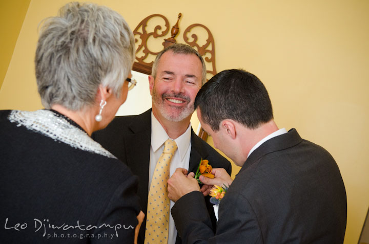 Groom help his father putting on boutonniere. The Tidewater Inn Wedding, Easton Maryland, getting ready photo coverage of Kelsey and Jonnie by wedding photographers of Leo Dj Photography.