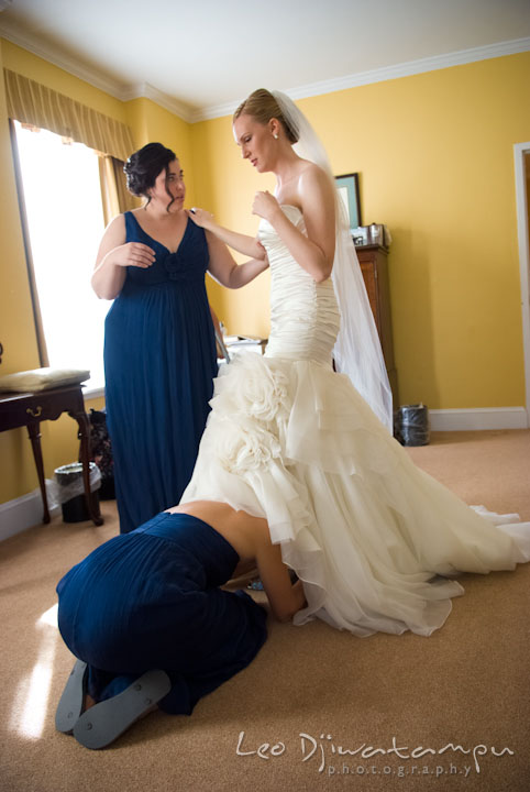 Matron of honor help bride put on shoes. The Tidewater Inn Wedding, Easton Maryland, getting ready photo coverage of Kelsey and Jonnie by wedding photographers of Leo Dj Photography.