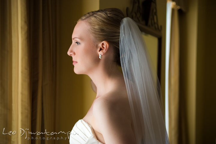 Bride looking out the window. The Tidewater Inn Wedding, Easton Maryland, getting ready photo coverage of Kelsey and Jonnie by wedding photographers of Leo Dj Photography.