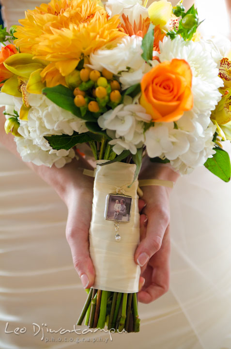 Locket on flower bouquet with photo of bride and her late father. The Tidewater Inn Wedding, Easton Maryland, getting ready photo coverage of Kelsey and Jonnie by wedding photographers of Leo Dj Photography.