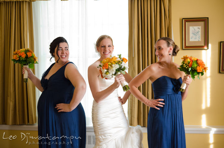 Bride and matrons of honor posing with their flower bouquets. The Tidewater Inn Wedding, Easton Maryland, getting ready photo coverage of Kelsey and Jonnie by wedding photographers of Leo Dj Photography.
