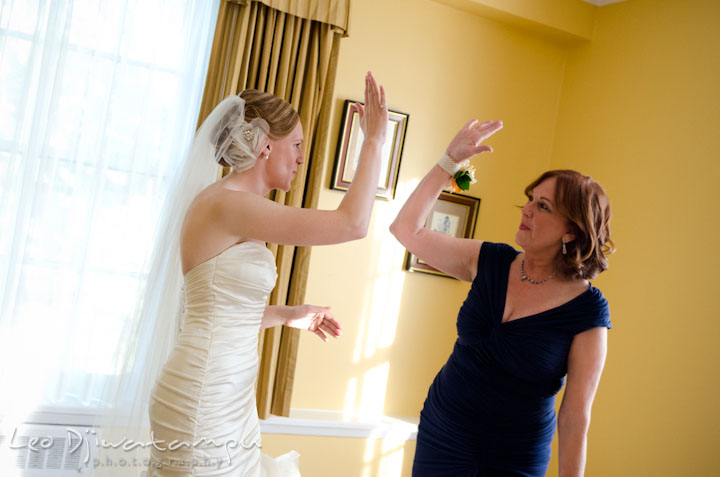 Bride giving high five to her mother. The Tidewater Inn Wedding, Easton Maryland, getting ready photo coverage of Kelsey and Jonnie by wedding photographers of Leo Dj Photography.