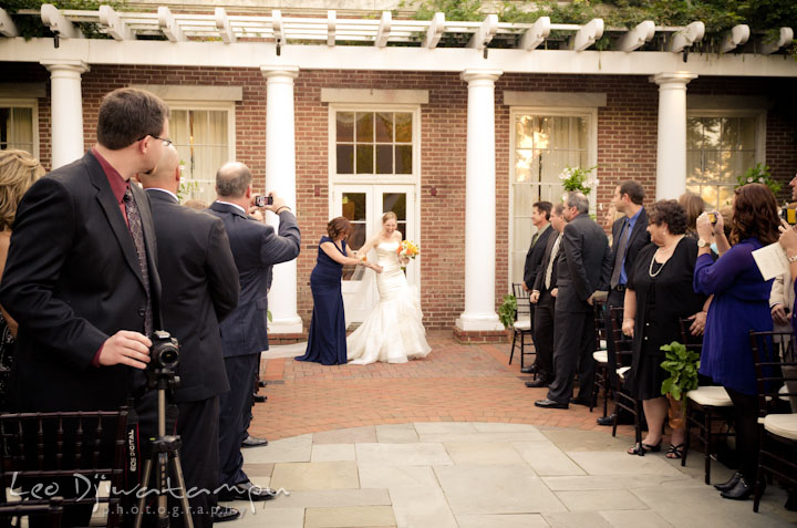 Bride escorted by mother during procession. The Tidewater Inn Wedding, Easton Maryland, ceremony photo coverage of Kelsey and Jonnie by wedding photographers of Leo Dj Photography.. The Tidewater Inn Wedding, Easton Maryland, ceremony photo coverage of Kelsey and Jonnie by wedding photographers of Leo Dj Photography.