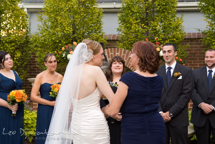 Mother handing over bride to groom. The Tidewater Inn Wedding, Easton Maryland, ceremony photo coverage of Kelsey and Jonnie by wedding photographers of Leo Dj Photography.