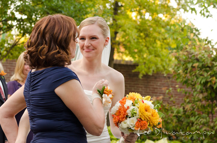 Mother wants to hug bride. The Tidewater Inn Wedding, Easton Maryland, ceremony photo coverage of Kelsey and Jonnie by wedding photographers of Leo Dj Photography.