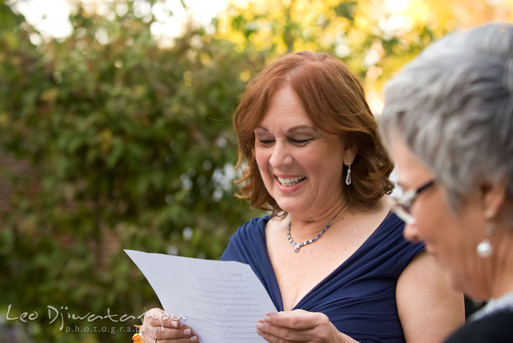 Mother of bride reading letter to bride and groom. The Tidewater Inn Wedding, Easton Maryland, ceremony photo coverage of Kelsey and Jonnie by wedding photographers of Leo Dj Photography.
