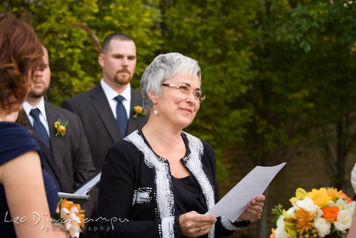 Mother of groom reading letter to bride and groom. The Tidewater Inn Wedding, Easton Maryland, ceremony photo coverage of Kelsey and Jonnie by wedding photographers of Leo Dj Photography.