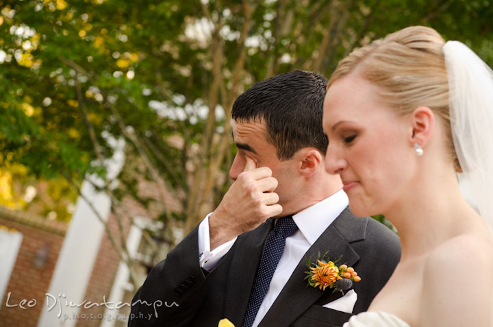 Groom wiping of tears from his eyes. The Tidewater Inn Wedding, Easton Maryland, ceremony photo coverage of Kelsey and Jonnie by wedding photographers of Leo Dj Photography.