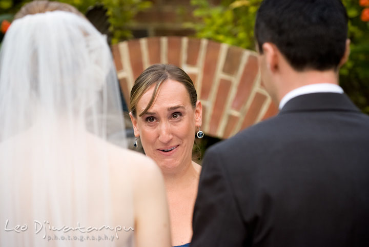 Matron of honor reading letter to bride and groom. The Tidewater Inn Wedding, Easton Maryland, ceremony photo coverage of Kelsey and Jonnie by wedding photographers of Leo Dj Photography.