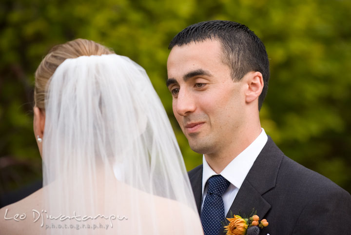 Groom looking at bride with lots of love while reciting vow. The Tidewater Inn Wedding, Easton Maryland, ceremony photo coverage of Kelsey and Jonnie by wedding photographers of Leo Dj Photography.