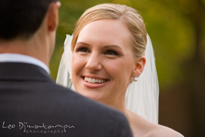 Bride smile at groom while reciting wedding vow. The Tidewater Inn Wedding, Easton Maryland, ceremony photo coverage of Kelsey and Jonnie by wedding photographers of Leo Dj Photography.