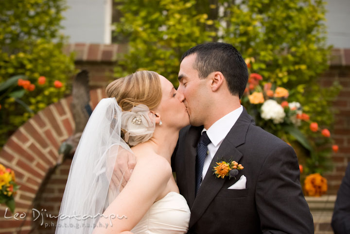 Bride and groom kissed each other. The Tidewater Inn Wedding, Easton Maryland, ceremony photo coverage of Kelsey and Jonnie by wedding photographers of Leo Dj Photography.