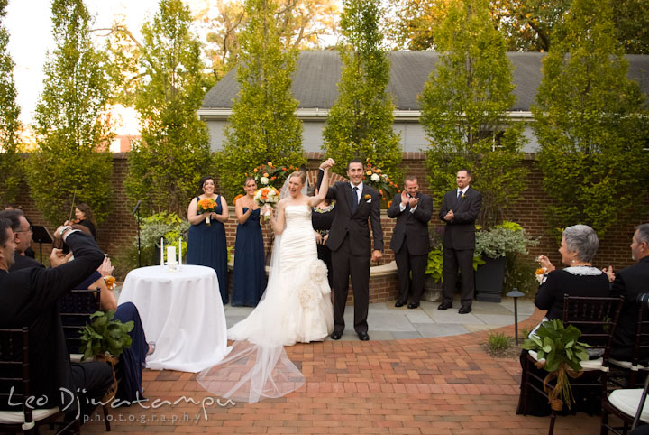 Officiant, introduced the married couple for the first time. The Tidewater Inn Wedding, Easton Maryland, ceremony photo coverage of Kelsey and Jonnie by wedding photographers of Leo Dj Photography.