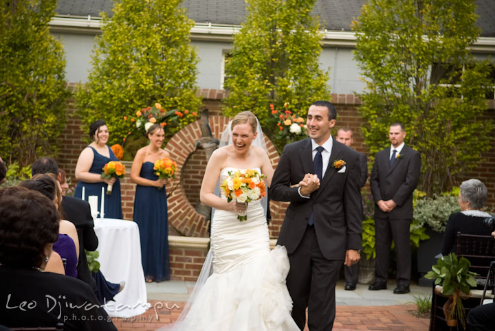 Bride and groom walking out. The Tidewater Inn Wedding, Easton Maryland, ceremony photo coverage of Kelsey and Jonnie by wedding photographers of Leo Dj Photography.