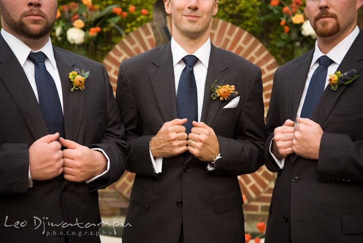 Groom and best men showing jackets, ties, and their boutonniere. The Tidewater Inn Wedding, Easton Maryland, ceremony photo coverage of Kelsey and Jonnie by wedding photographers of Leo Dj Photography.