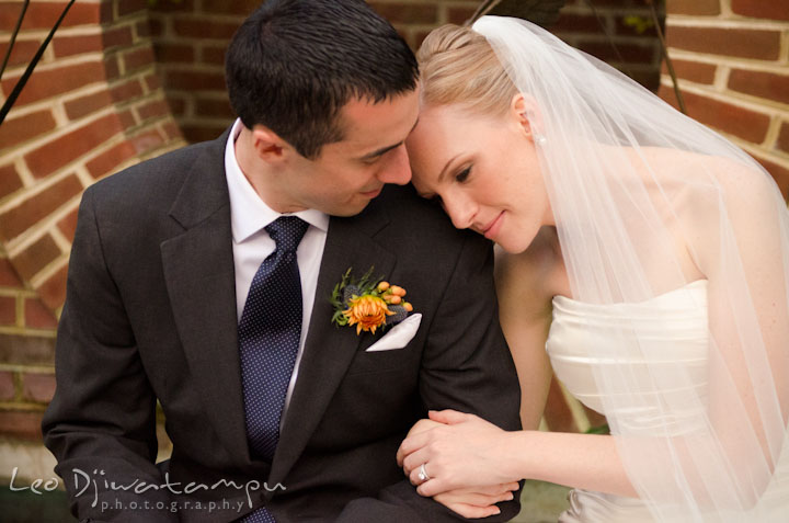 Bride leaning her head on groom's shoulder. The Tidewater Inn Wedding, Easton Maryland, ceremony photo coverage of Kelsey and Jonnie by wedding photographers of Leo Dj Photography.