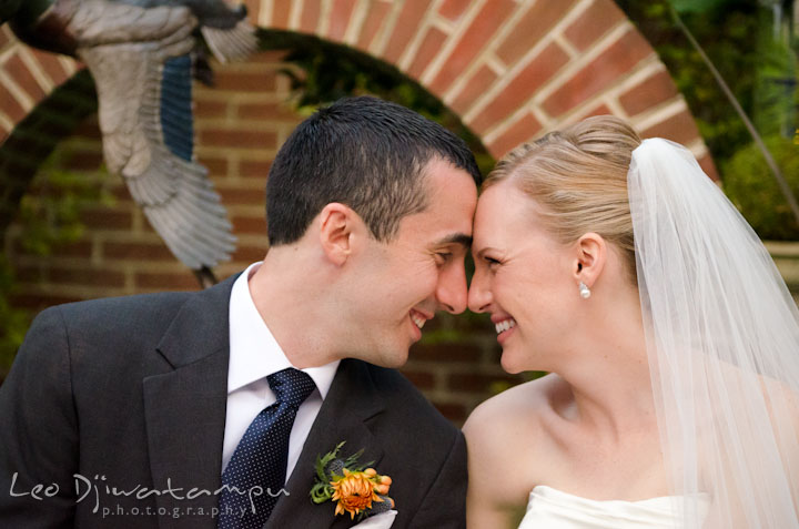 Bride and groom smiling together. The Tidewater Inn Wedding, Easton Maryland, ceremony photo coverage of Kelsey and Jonnie by wedding photographers of Leo Dj Photography.