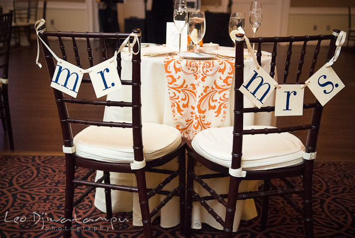Mr and Mrs chair paper decoration, sweetheart table. The Tidewater Inn Wedding, Easton Maryland, reception photo coverage of Kelsey and Jonnie by wedding photographers of Leo Dj Photography.
