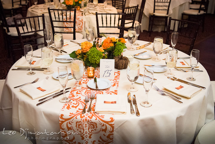 Table setting with the flower center piece. The Tidewater Inn Wedding, Easton Maryland, reception photo coverage of Kelsey and Jonnie by wedding photographers of Leo Dj Photography.